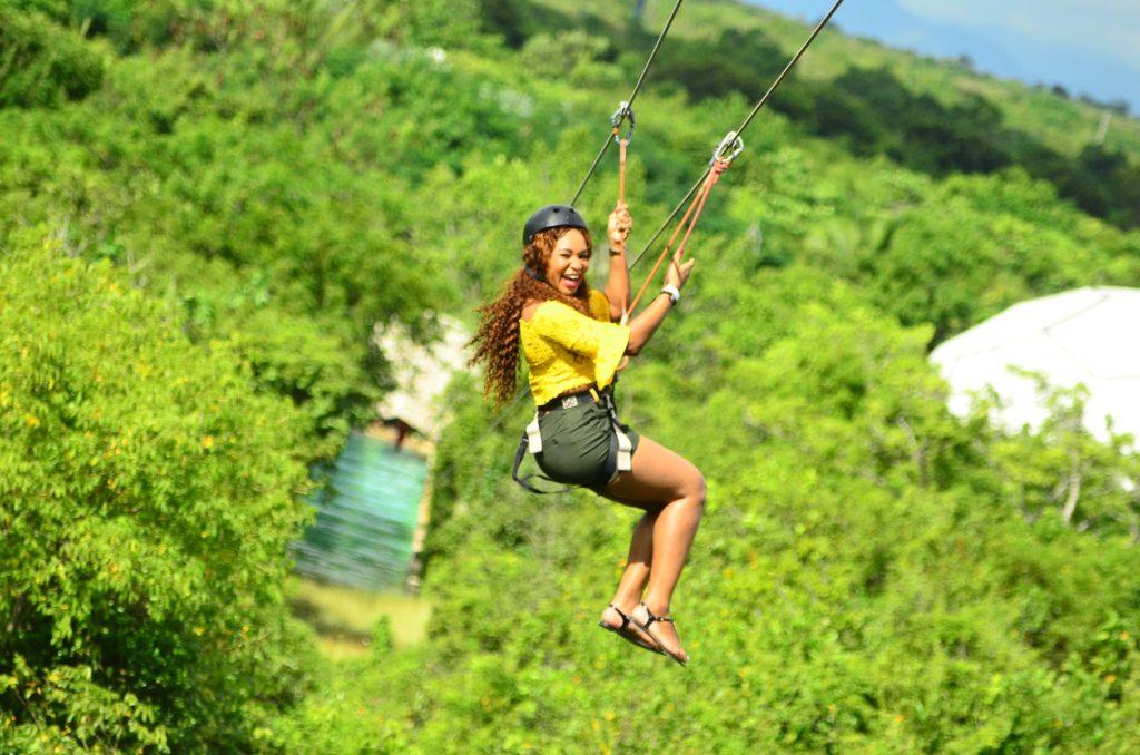 Woman ziplining in jungle