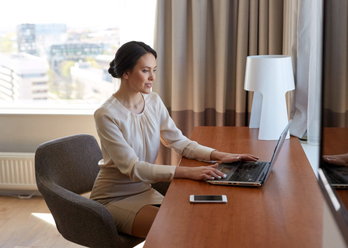 Woman working in hotel room