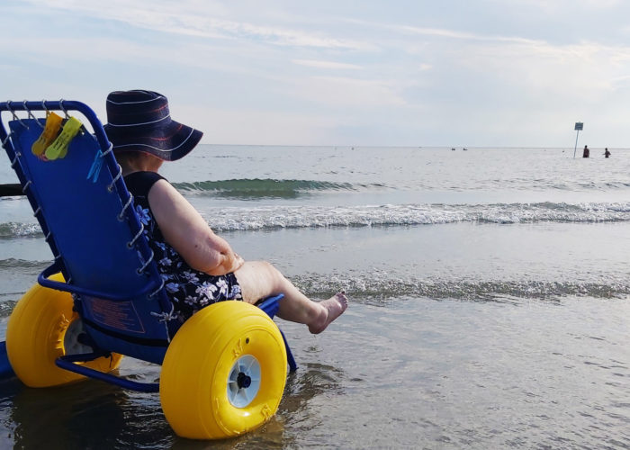 Woman in beach wheelchair