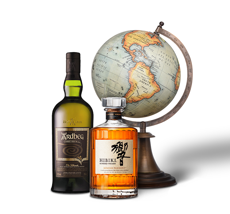 Two bottles of whiskey in front of a globe