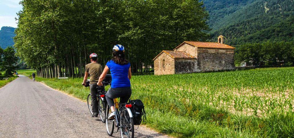 People biking along a country path