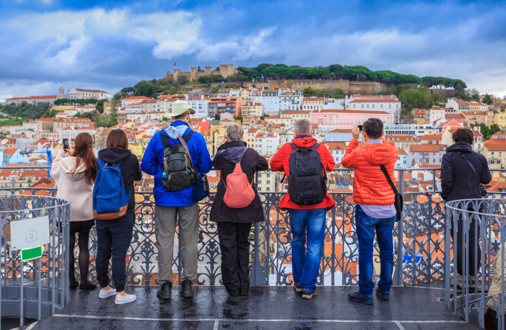 Group of tourists looking at the skyline of Lisbon