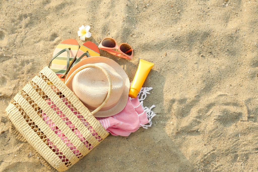 Beach bag spilled across the sand