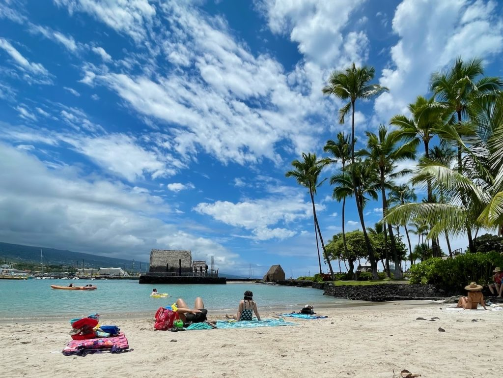 People resting on the beach in Hawaii