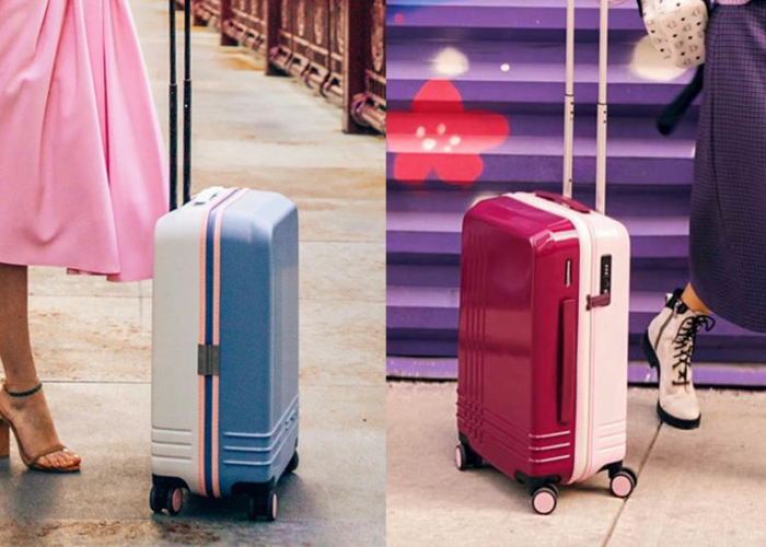 Two women with personalized luggage