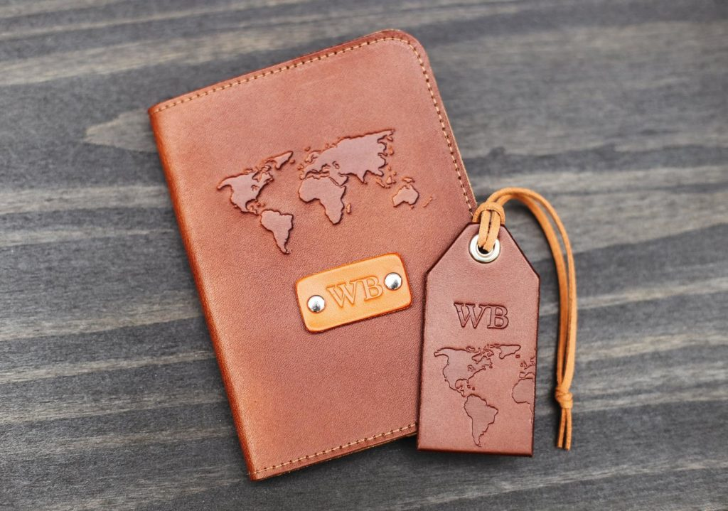 Leather passport cover and luggage tag with world map design