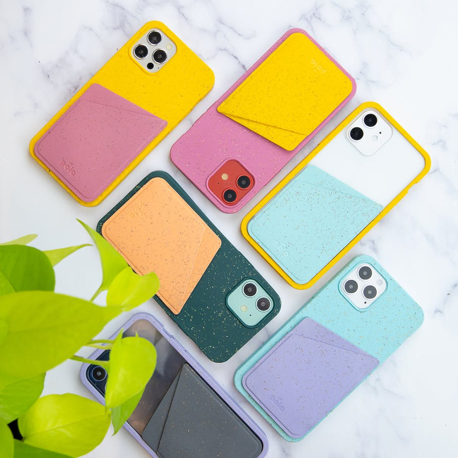 Several colors of Pela phone case with attachable card holder on marble background