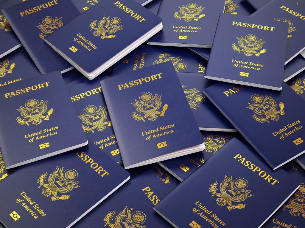 Several United States passports piled on top of each other