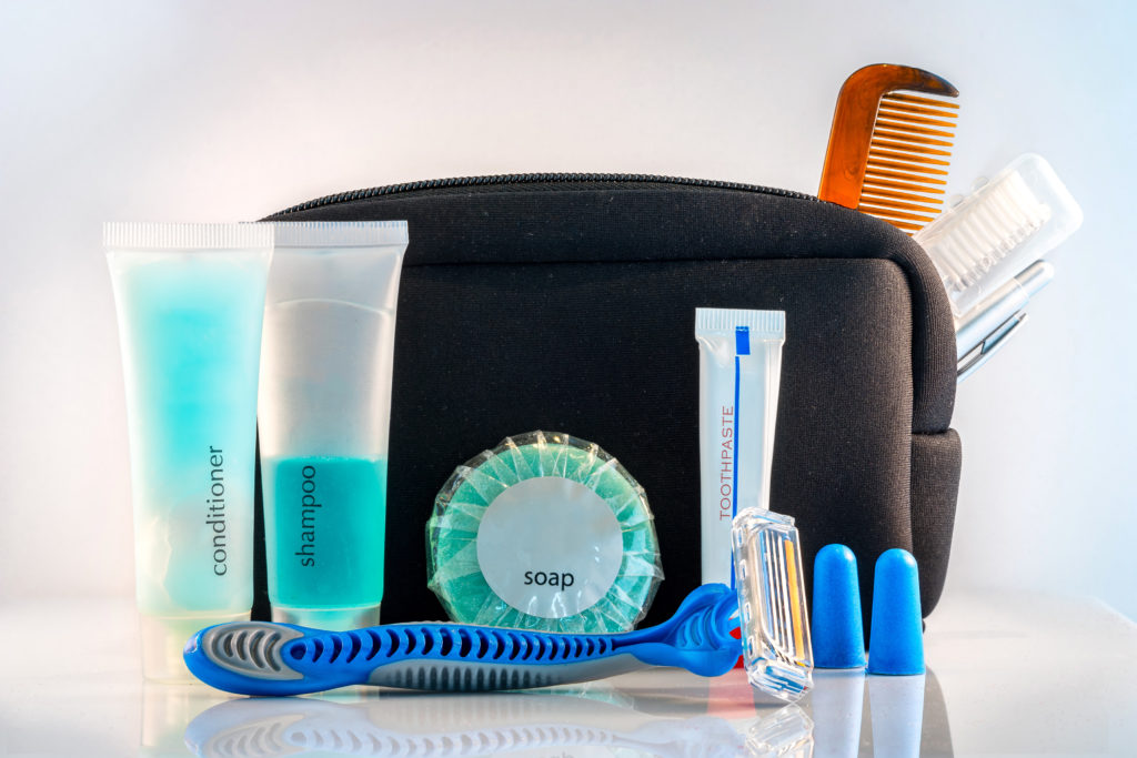 A travel toiletry kit on a white background