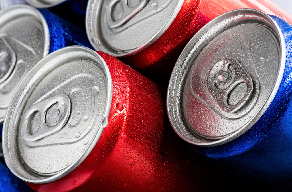 Red and blue cans of soft drinks