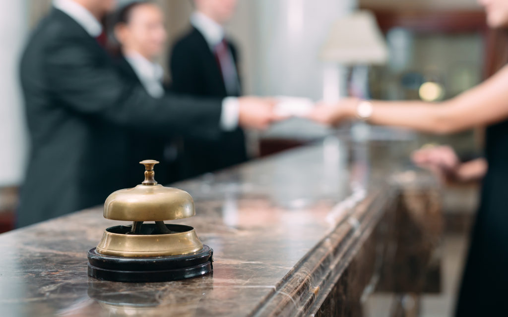 Guests checking in at hotel counter