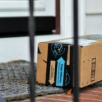 Amazon box on front porch of house