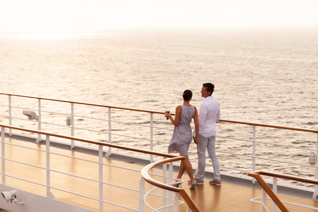 Couple strolling on cruise ship deck