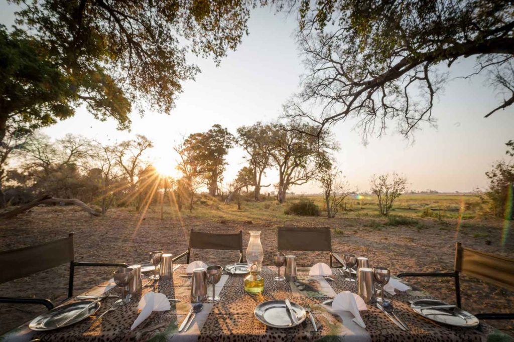 Dining table laid out in the wilderness on an Afrika Ecco Mobile Safari