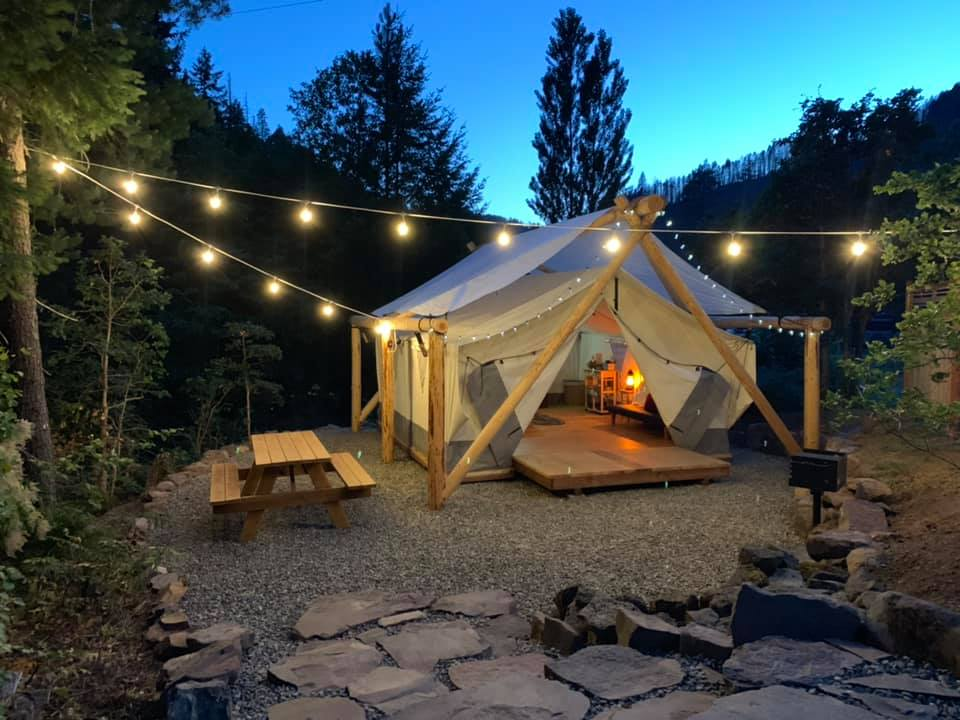 Glamping tent and outdoor area at Umpqua's Last Resort, Wilderness Cabins, RV Park & Glamping