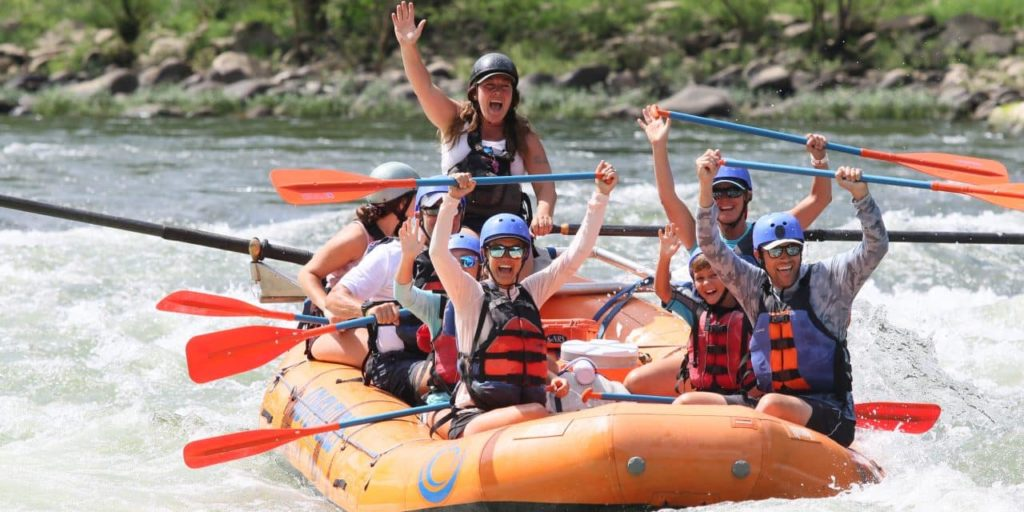 A group of people white water rafting at New River Gorge National Park and Preserve