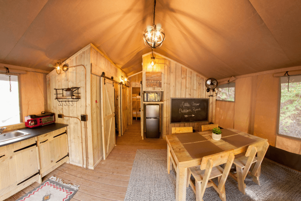 The inside of a glamping tent at Little Arrow Outdoor Resort
