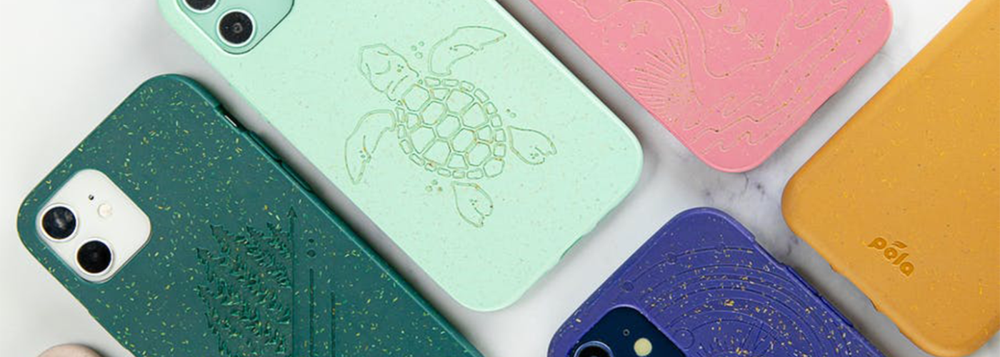 Several colors of Pela phone case on a white marble background