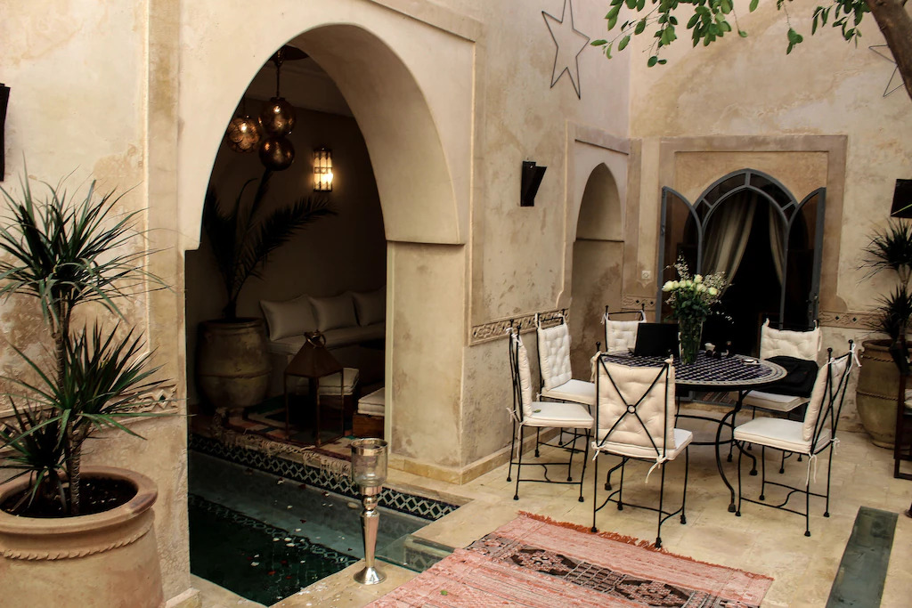 A sitting area and archway in a vacation home in Marrakech, Morocco