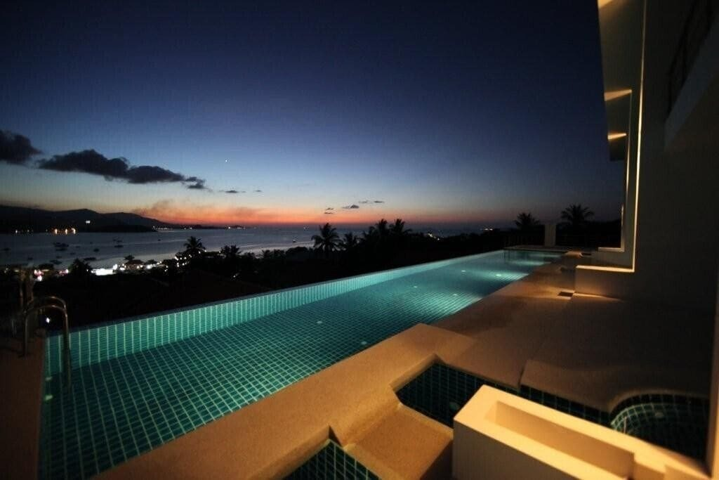 A swimming pool at night in Koh Samui, Thailand