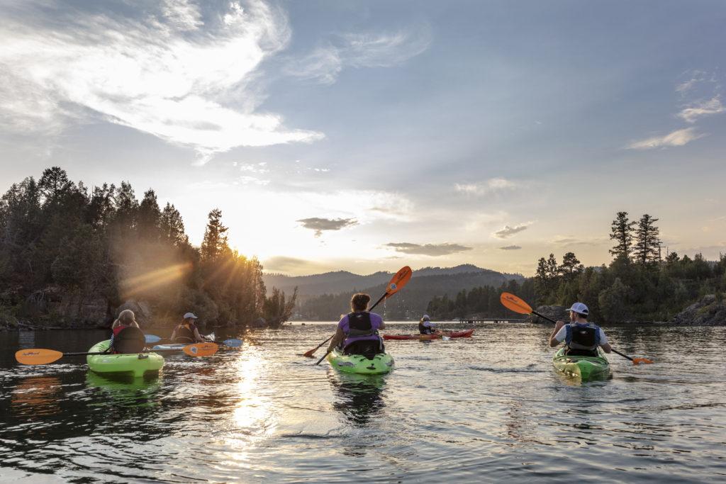 Group kayaking on Flathead Lake, Montana