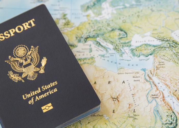Passport on a world map backdrop