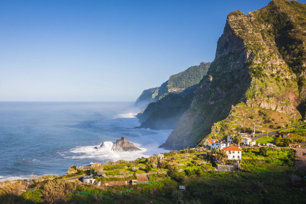 View of mountains and ocean on coast near Boaventura, Madeira island, Portugal