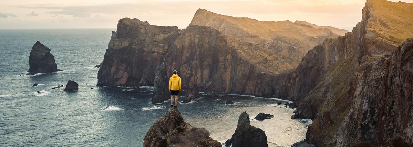 Hikers overlooking cliffs and ocean