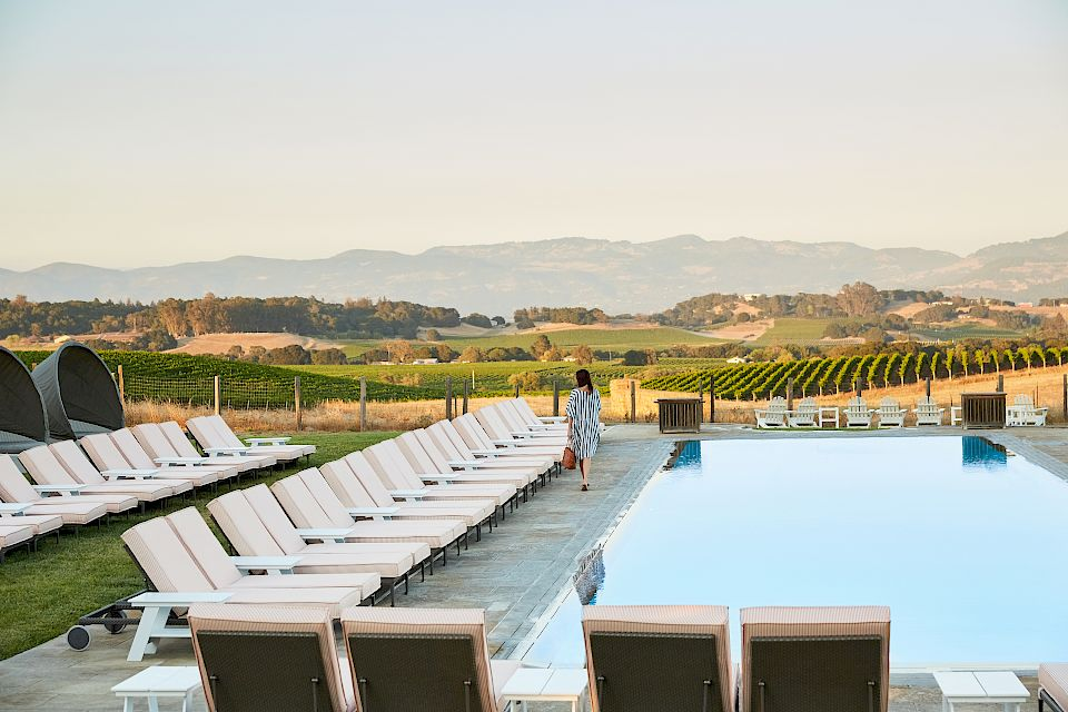 Woman walking by the Adults Only pool at Carneros Resort and Spa