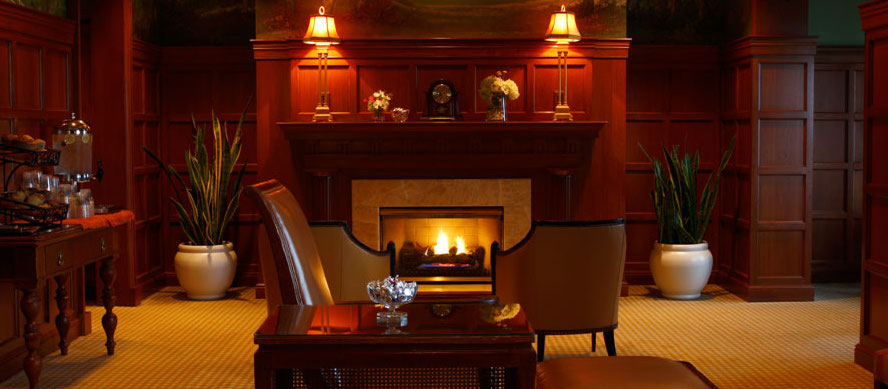 Sitting room with lit fireplace at the Spa at Hotel Hershey