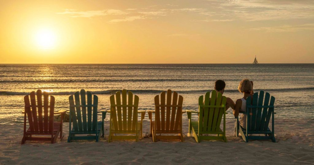 Couple watching the sunset on the beach at the Divi Carina Bay Beach Resort & Casino, St. Croix