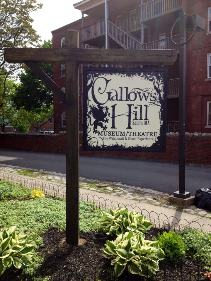The front sign for Gallows Hill Museum and Theatre in Salem, Massachusetts