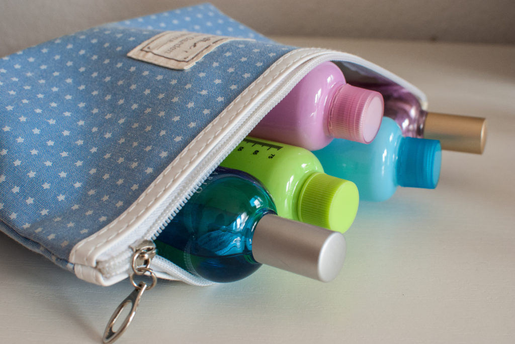 Blue toiletries bag filled with small travel toiletries