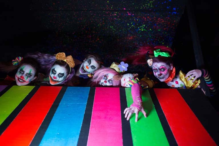 Clowns crawling up from behind a rainbow floor at The Haunted Hotel, California