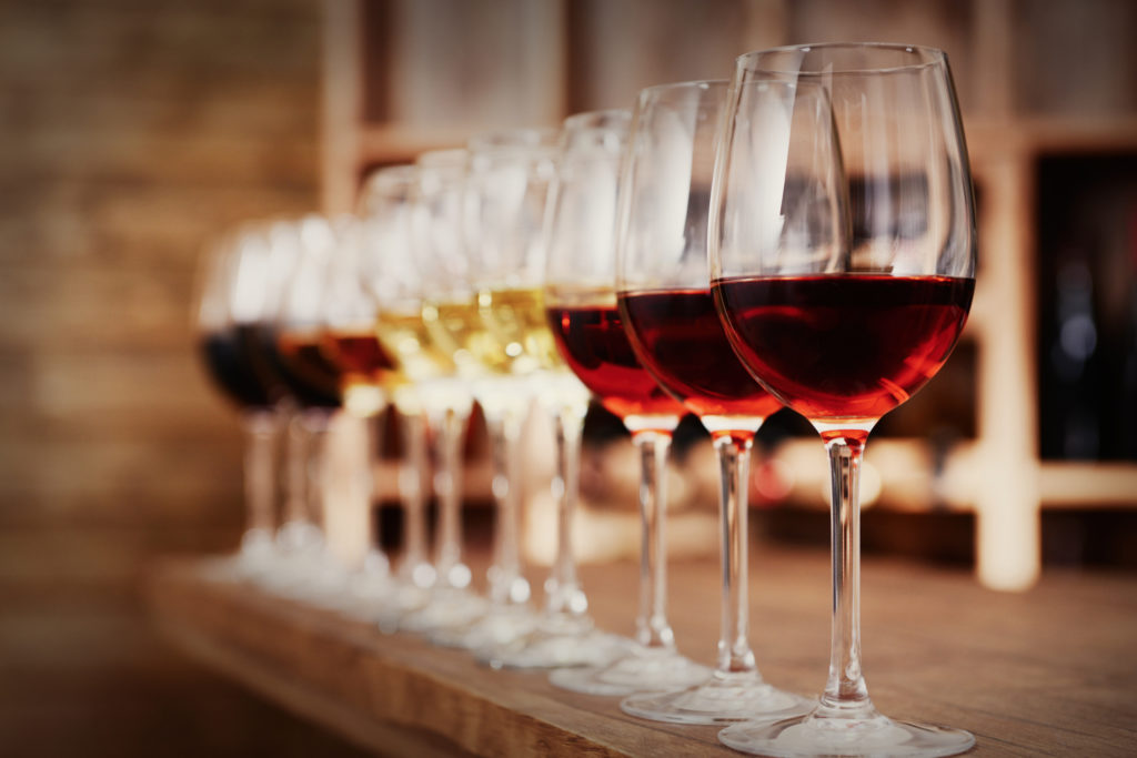 Row of glasses of red and white wine